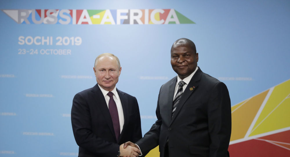 Russian President Vladimir Putin and Central African Republic President Faustin Archange Touadera shake hands as they pose for a photo prior to their meeting at the 2019 Russia-Africa Summit and Economic Forum in Sochi, Russia
