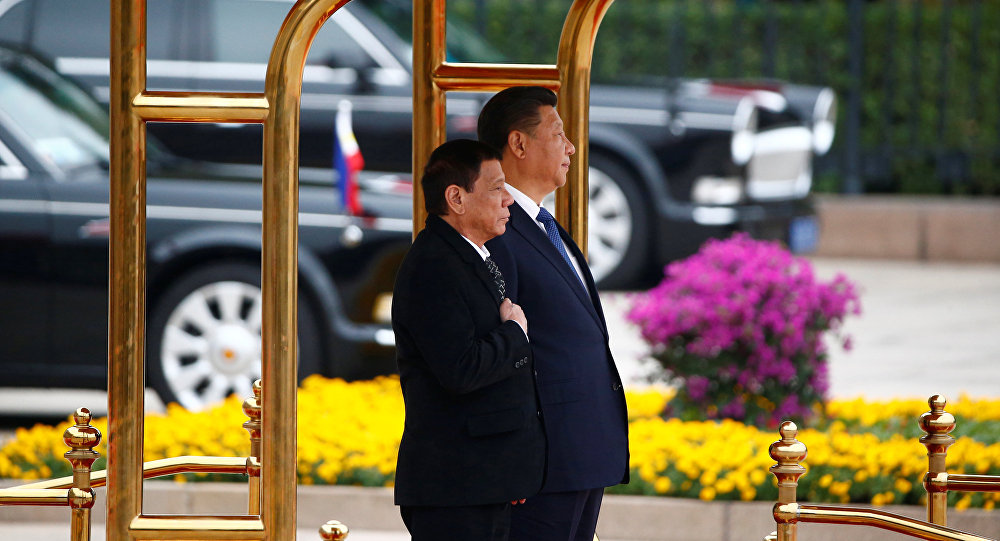 President of the Philippines Rodrigo Duterte (L) and Chinese President Xi Jinping attend a welcoming ceremony at the Great Hall of the People in Beijing, China, October 20, 2016.