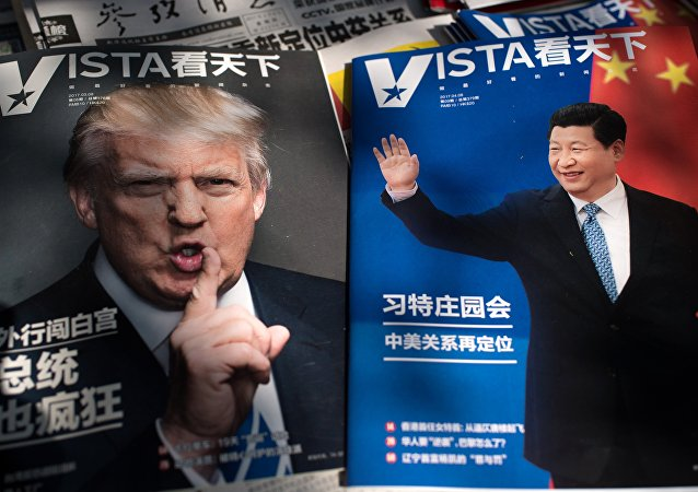 Magazines featuring front pages of US President Donald Trump (L) and China's President Xi Jinping (R) are displayed at a news stand in Beijing