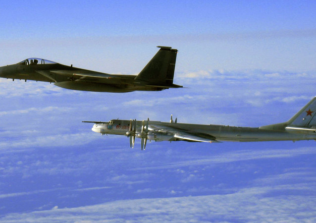 Tu-95 strategic bomber, escorted by a US Air Force F-15C Eagle off the coast of Alaska, 2006.