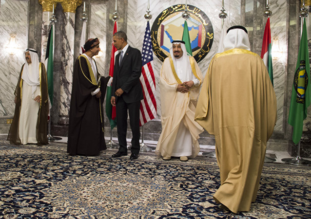 King of Saudi Arabia Salman bin Abdulaziz al-Saud (2nd L) looks on a s US President Barack Obama (3rd L) speaks with Oman Deputy Prime Minister for the Council of Ministers Sayyid Fahd bin Mahmoud al-Said (2nd L) during the family photo for the US-Gulf Cooperation Council Summit in Riyadh, on April 21, 2016