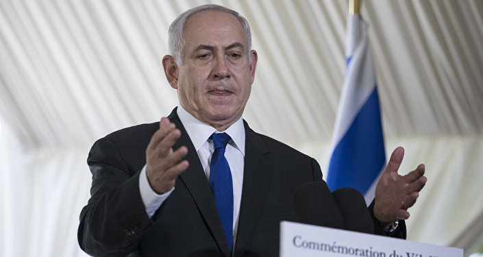 Israeli Prime Minister Benjamin Netanyahu gestures as he delivers a speech during a ceremony commemorating the 75nd anniversary of the Vel d'Hiv roundup, Sunday, July 16, 2017 in Paris