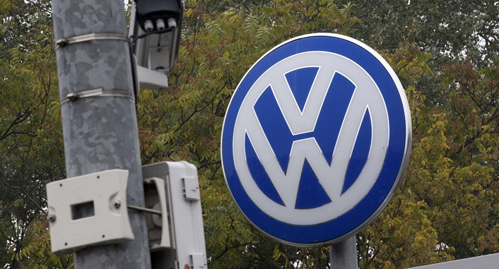 A Volkswagen logo stands next to a CCTV security camera in Wolfsburg, Germany October 7, 2015