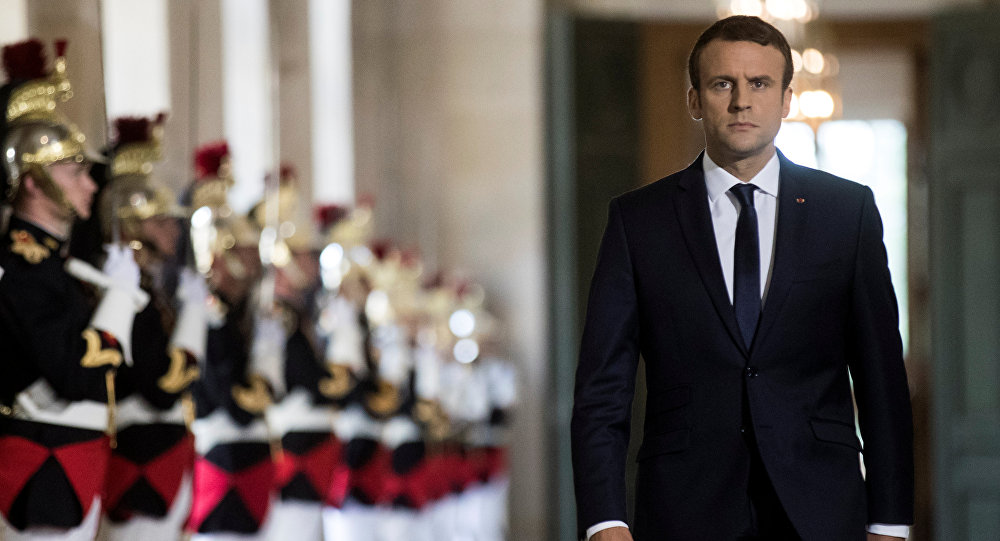 French President Emmanuel Macron walks through the Galerie des Bustes (Busts Gallery) to access the Versailles Palace's hemicycle for a special congress gathering both houses of parliament (National Assembly and Senate), near Paris, France, July 3, 2017.