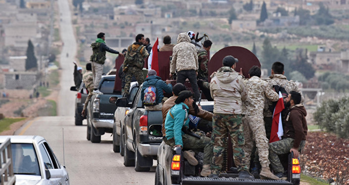 A picture taken on February 20, 2018 shows a convoy of pro-Syrian government fighters arriving in Syria's northern region of Afrin