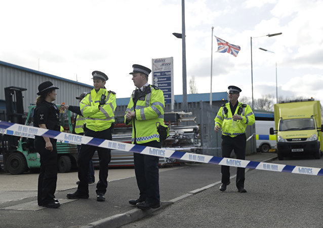 Police officers secure a cordon outside the vehicle recovery business Ashley Wood Recovery in Salisbury, England, Tuesday, March 13, 2018