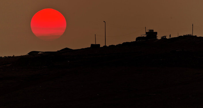 A soldier walks at a Turkish military outpost