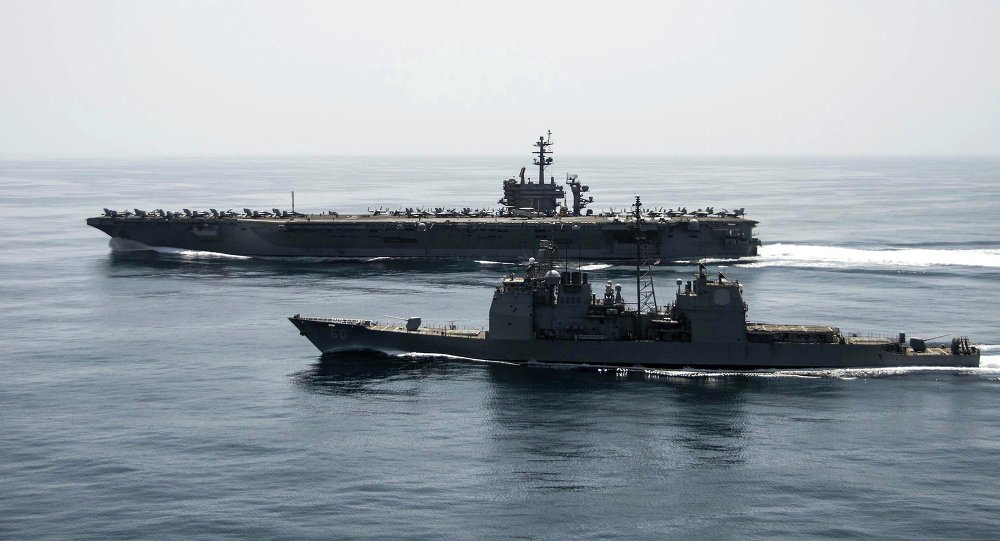 The aircraft carrier USS Theodore Roosevelt (CVN 71) and the guided-missile cruiser USS Normandy (CG 60) operate in the Arabian Sea conducting maritime security operations in this U.S. Navy photo taken April 21, 2015