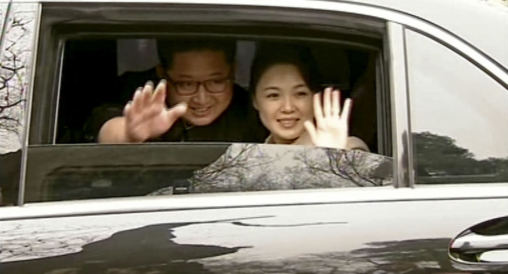 Kim Jong Un and his wife Ri Sol Ju in Beijing