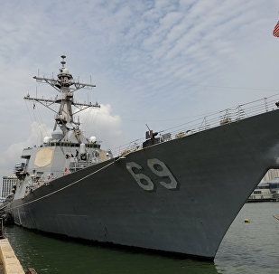 A general view shows the USS Milius DDG69, a multi-mission capable guided missile destroyer ship docked at the Manila south harbour on August 18, 2012.