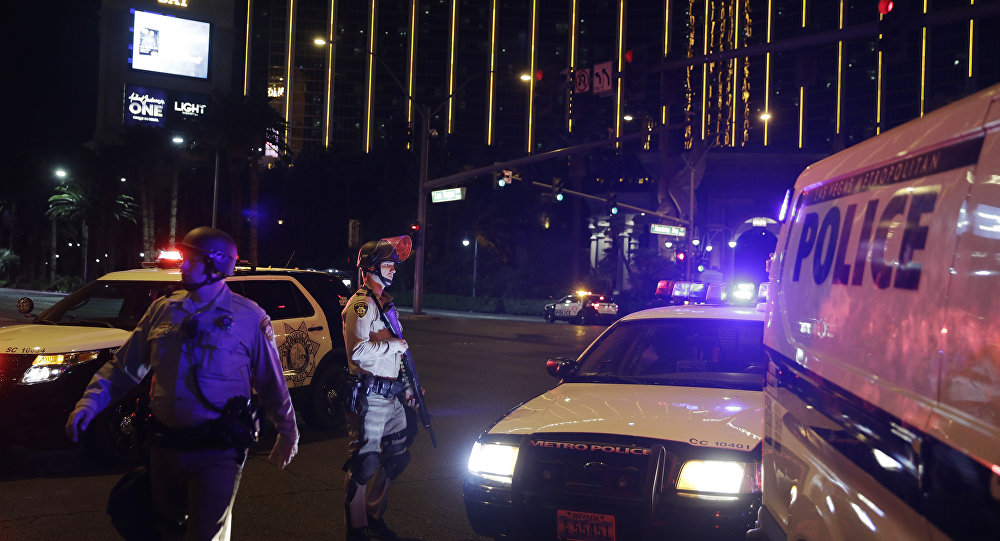 Police officers stand along the Las Vegas Strip outside the Mandalay Bay resort and casino during a deadly shooting near the casino, Sunday, Oct. 1, 2017, in Las Vegas