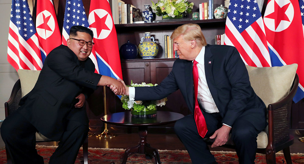 U.S. President Donald Trump shakes hands with North Korea's leader Kim Jong Un before their bilateral meeting at the Capella Hotel on Sentosa island in Singapore June 12, 2018.