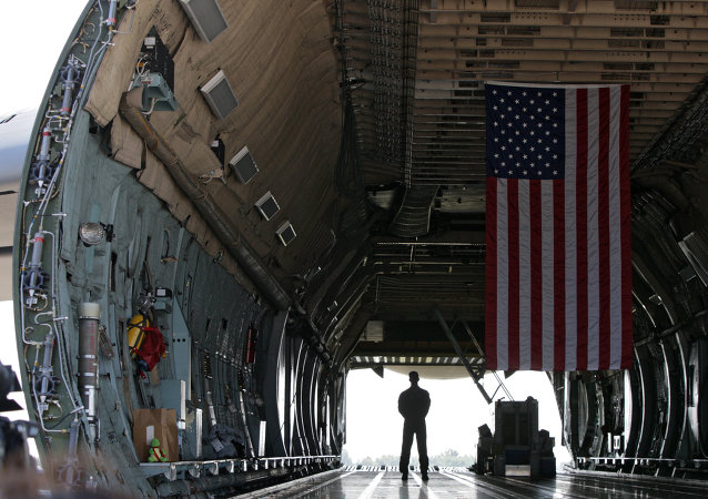 A serviceman stands inside the US military transport aircraft C-5 Galaxy