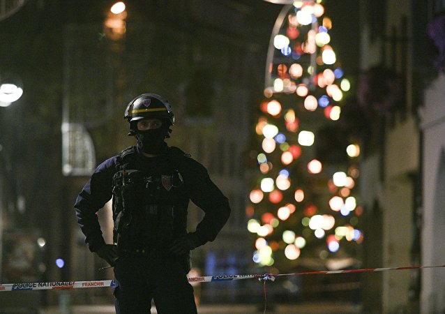 A policeman patrols in the rue des Grandes Arcades in Strasbourg, eastern France, after a shooting breakout, on December 11, 2018.