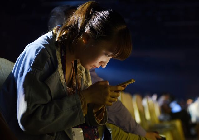 A woman uses a mobile phone