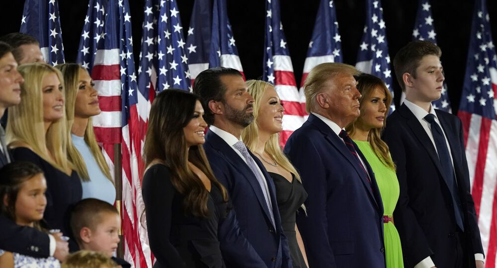 From left, Jared Kushner and his wife Ivanka Trump, Eric and Lara Trump, Kimberly Guilfoyle and Donald Trump Jr., Tiffany Trump, President Donald Trump and first lady Melania Trump and Barron Trump stand on stage on the South Lawn of the White House on the fourth day of the Republican National Convention, Thursday, Aug. 27, 2020, in Washington