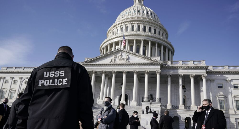 High level security officials make a survey of the East Front of the Capitol after an announcement of security problems during a rehearsal for the 59th Presidential Inauguration at the U.S. Capitol in Washington, Monday, Jan. 18, 2021. (AP Photo/J. Scott Applewhite)