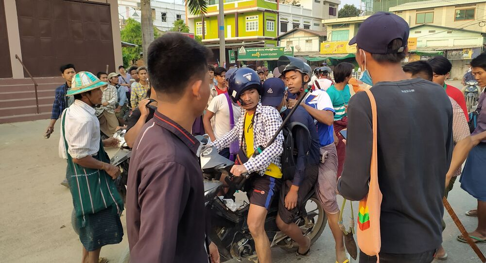 Demonstrators are seen before a clash with security forces in Taze, Sagaing Region, Myanmar April 7, 2021, in this image obtained by Reuters.
