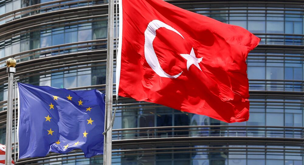 A European Union (L) and Turkish flag fly outside a hotel in Istanbul, Turkey, May 4, 2016.