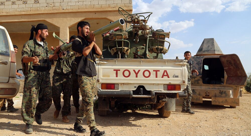 US-backed Kurdish and Arab fighters prepare a rocket-launcher as they advance into the Islamic State (IS) jihadist's group bastion of Manbij, in northern Syria (File)
