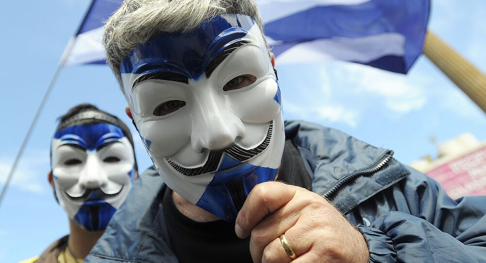 Pro-Scottish Independence supporters with Scottish Saltire flag masks pose for a picture at a rally in George Square in Glasgow, Scotland on July 30, 2016 to call for Scottish independence from the UK.