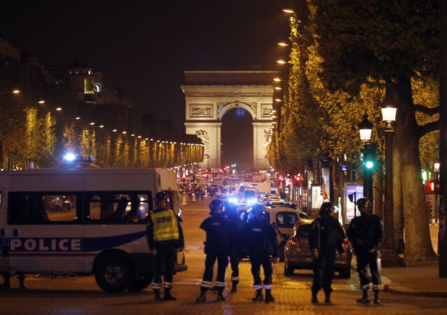 Police seal off the Champs Elysees avenue in Paris, France, after a fatal shooting in which a police officer was killed along with an attacker, Thursday, April 20, 2017. French media are reporting that two police officers were shot Thursday on the famed shopping boulevard.