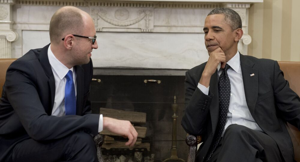 US President Barack Obama and Ukrainian Prime Minister Arseniy Yatsenyuk speak during meetings in the Oval Office of the White House in Washington, DC, March 12, 2014