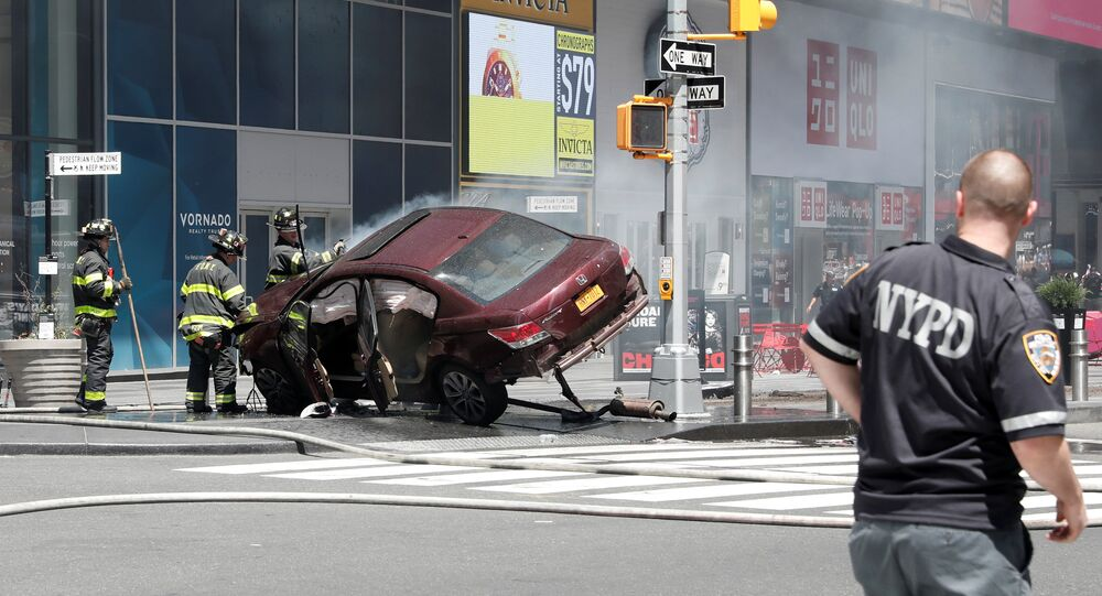A vehicle that struck pedestrians and later crashed is seen on the sidewalk in New York City, U.S., May 18, 2017.