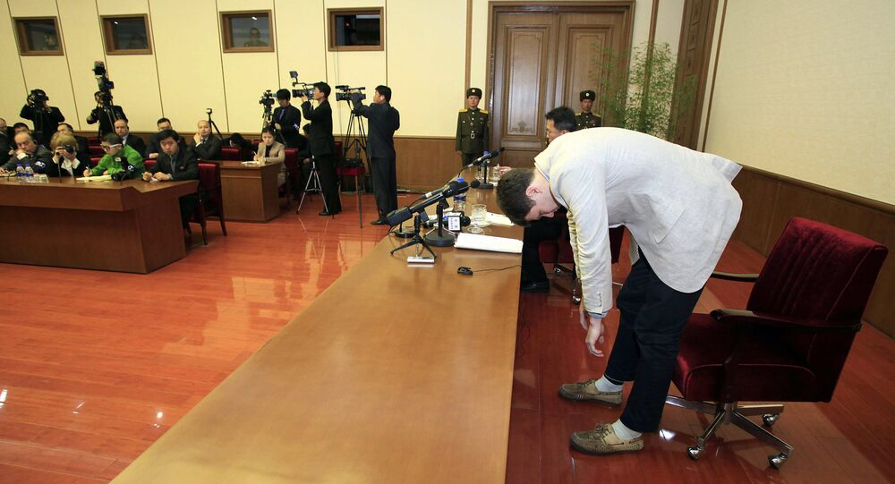 American student Otto Warmbier, right, bows as Warmbier is presented to the reporters on Monday, Feb. 29, 2016, in Pyongyang, North Korea