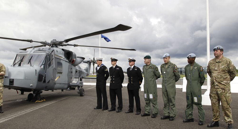British forces' personnel stand to attention in front of a new AgustaWestland AW159 Wildcat helicopter at the Farnborough International Airshow in Farnborough, England (file)
