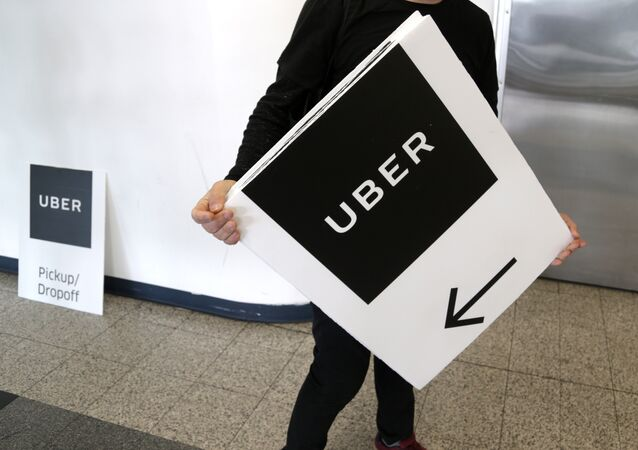 An Uber representative put up signs at LaGuardia Airport in New York, Wednesday, March 15, 2017.