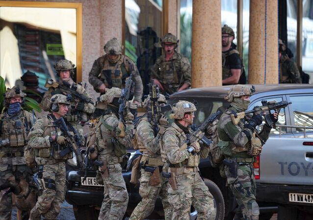 French soldiers arrive at the site of the attack in Ouagadougou, Burkina Faso, January 16, 2016.