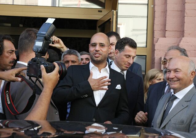 Saif al-Islam Gaddafi visits The Desert is Not Silent exhibition of Libya's ancient and contemporary art. File photo