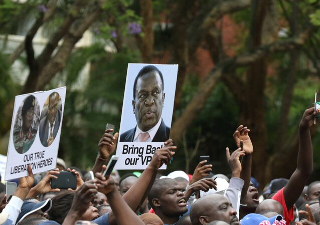 Protesters hold posters showing support for former vice-President Emmerson Mnangagwa, in Harare, Zimbabwe, November 18, 2017