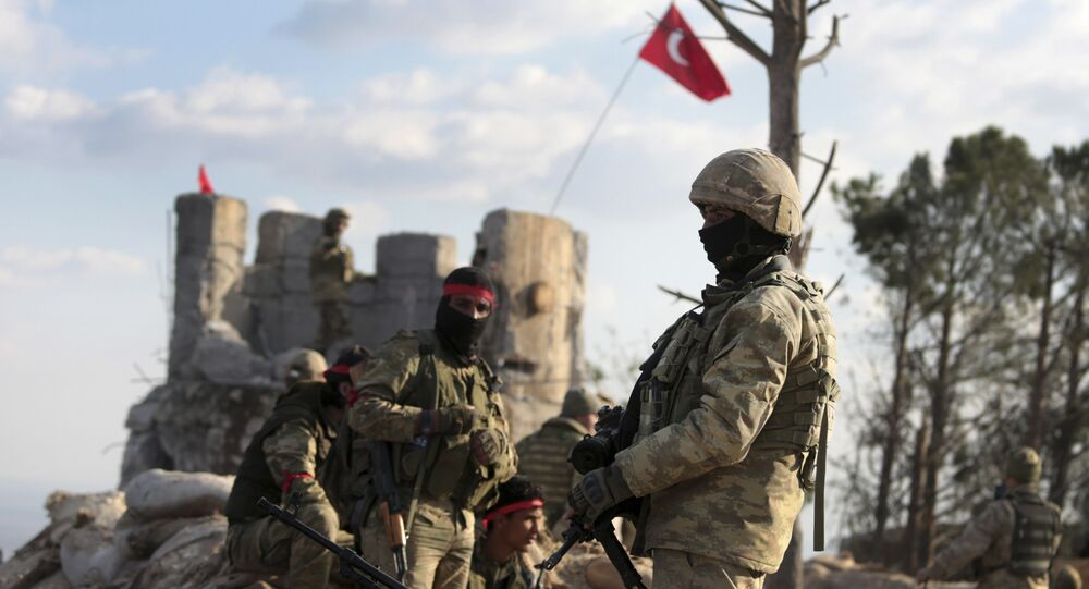 Pro-Turkey Syrian fighters and Turkish troops secure the Bursayah hill, which separates the Kurdish-held enclave of Afrin from the Turkey-controlled town of Azaz, Syria, Sunday, Jan. 28, 2018