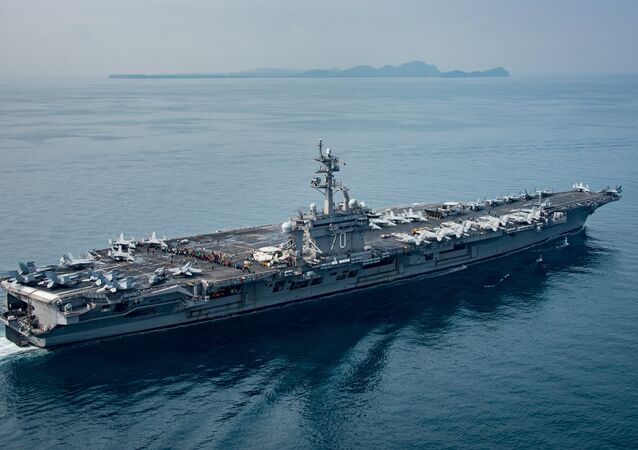 The U.S. aircraft carrier USS Carl Vinson transits the Sunda Strait, Indonesia on April 15, 2017. Picture taken on April 15, 2017