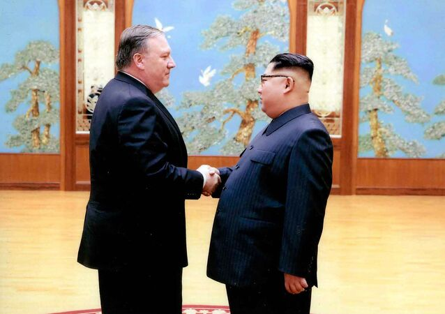 In this image released by the White House, then-CIA director Mike Pompeo shakes hands with North Korean leader Kim Jong Un in Pyongyang, North Korea, during a 2018 East weekend trip.