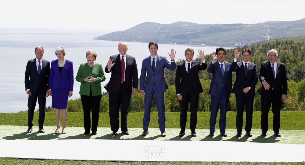 Leaders pose for family photo at the G7 Summit in Charlevoix