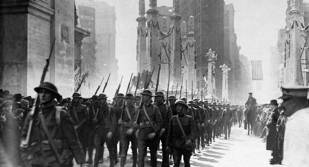 Soldiers returned to the U.S. from France after the Great War march in a homecoming parade in Madison Square, New York City, 1918