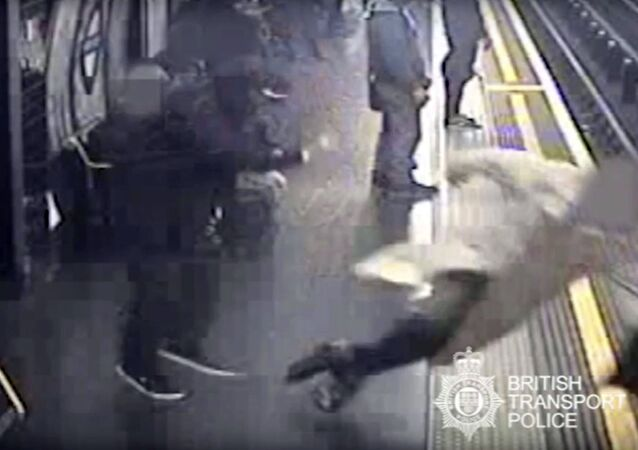This handout grab taken from CCTV issued by British Transport Police shows Robert Malpas being pushed onto the tracks of Marble Arch Underground station in London