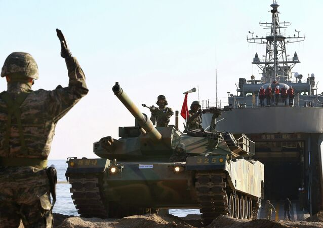 South Korean Marines take part in a landing operation which is a part of annual military exercise Hokuk, on a beach in Pohang November 18, 2014