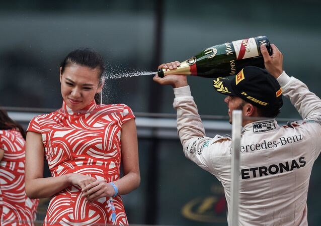 Mercedes AMG Petronas F1 Team's British driver Lewis Hamilton celebrates after winning the Formula One Chinese Grand Prix in Shanghai on April 12, 2015.