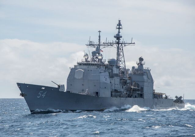 """This Mar. 6, 2016, file photo provided by the U.S. Navy, shows the Ticonderoga-class guided-missile cruiser USS Antietam (CG 54) sails in the South China Sea. China says it dispatched warships to identify and warn off a pair of U.S. Navy vessels sailing near one of its island claims in the South China Sea. A statement on the Defense Ministry's website said the Arleigh Burke class guided-missile destroyer USS Higgins and Ticonderoga class guided-missile cruiser USS Antietam entered waters China claims in the Paracel island group """"without the permission of the Chinese government."""""""