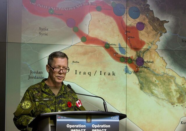Canadian Lieutenant-General Jonathan Vance, Commander of Canadian Joint Operation Command, holds a technical briefing on combat strikes against the Islamic State of Irag (ISIL) in Ottawa, at National Defence Heaquarters