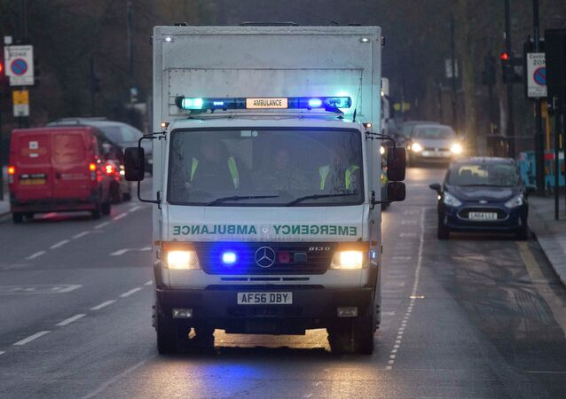 An ambulance carrying a female Ebola patient arrives at the Royal Free Hospital in London December 30, 2014. The patient, a voluntary health worker, was flown to London for specialist treatment at an isolation ward after being taken ill a day after returning from Sierra Leone