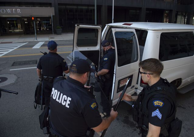DAYTON, OH - MAY 25: Police officers and Highway State Patrol officers prepare to respond to a rally held by the KKK affiliated group Honorable Sacred Knights of Indiana at Courthouse Square on May 25, 2019 in Dayton, Ohio.