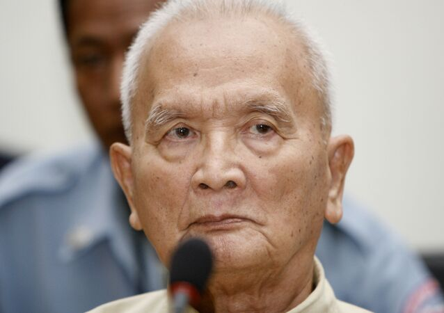 In this March, 20, 2008, file photo,  former Khmer Rouge's chief ideologist and No. 2 leader, Nuon Chea, foreground, sits in the court hall at the U.N.-backed war crimes tribunal in Phnom Penh, Cambodia.