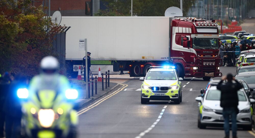 Police move the lorry container where bodies were discovered, in Grays, Essex, Britain October 23, 2019