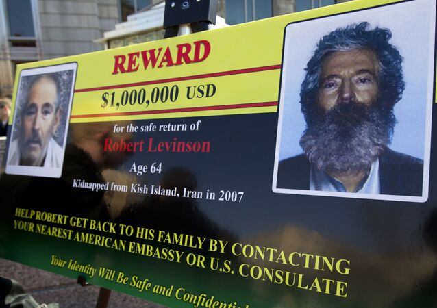 FBI poster showing a composite image of former FBI agent Robert Levinson, right, of how he would look like now after five years in captivity, and an image, left, taken from the video, released by his kidnappers, in Washington during a news conference