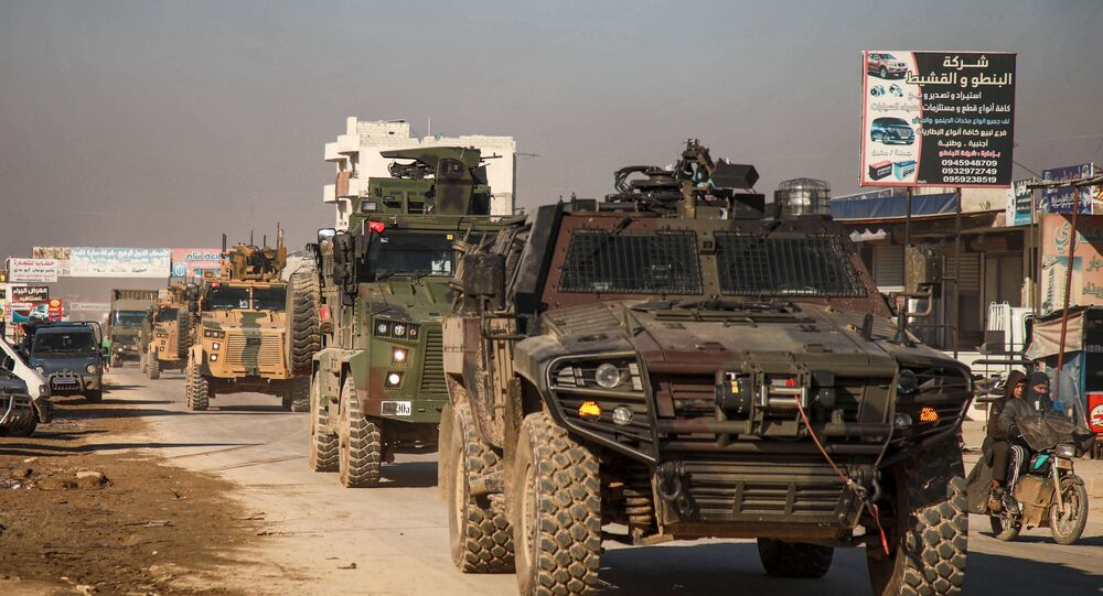 A Turkish military convoy of tanks and armoured vehicles passes through the Syrian town of Dana, east of the Turkish-Syrian border in the northwestern Syrian Idlib province, on February 2, 2020.